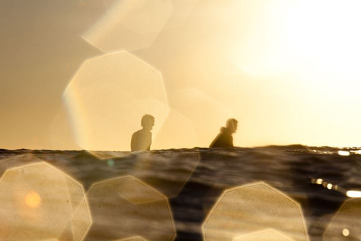 Two surfers wait for waves in the lineup during a surf trip in Central Baja, Mexico on December 15, 2011.