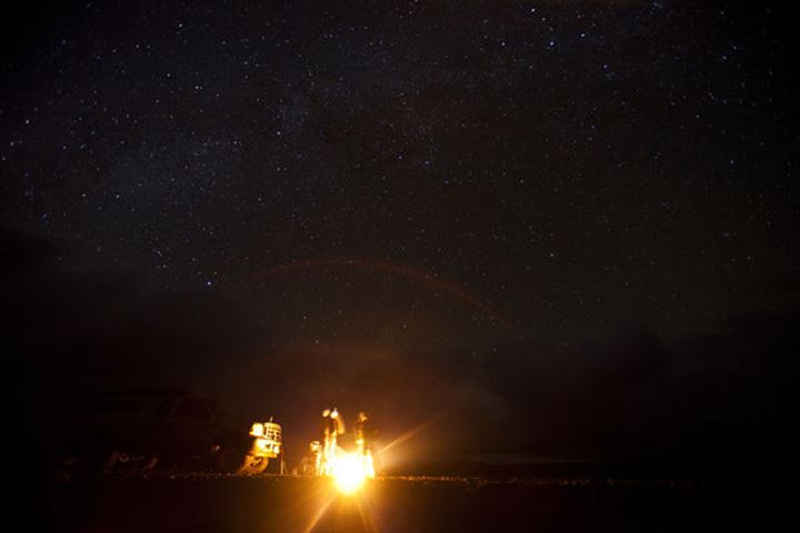 A group of surfers stand around a campfire in Central Baja, Mexico on December 12, 2011.  Due to the lack of civilization in this area of Baja the Milky Way was very visible.