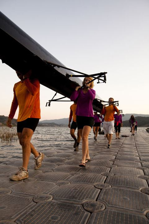 Men and women of the Lake Casitas Rowing Team carry their boat up a dock at Lake Casitas in Ojai, California on September 15, 2011.
