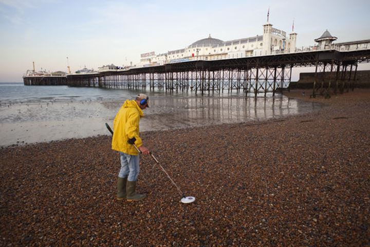 England, Sussex, Brighton, Brighton Pier, Metal Detecting on Brighton Beach