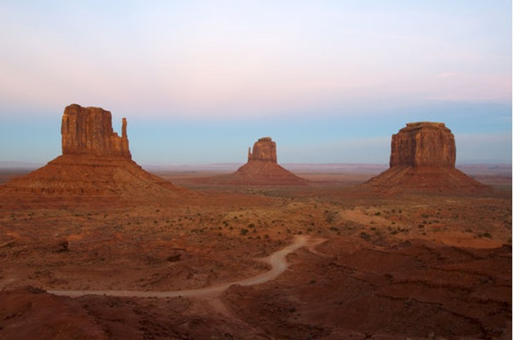 The classic view of Monument Valley as seen from the Visitor's Center, AZ. Monument Valley is located in the four corners area of the United States and is part of the Navajo Nation.