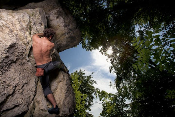 Antonio Caretta, a talented Italian climber, opens a difficult and exposed bouldering project, which starts with an overhanging and protruding rock feature deep in the forests of Hameln, Lower Saxony