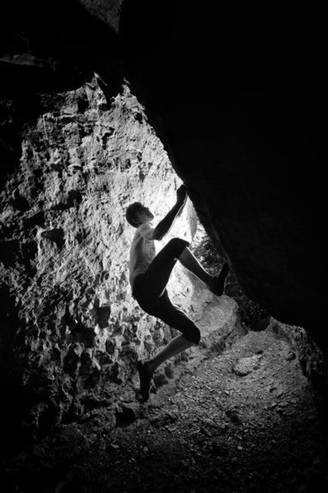 Davide Fracasso, an Italian climber, opens a difficult bouldering project inside cave hidden in densely vegetated forests surrounding Hameln, Lower Saxony, Germany on June 2 2011.
