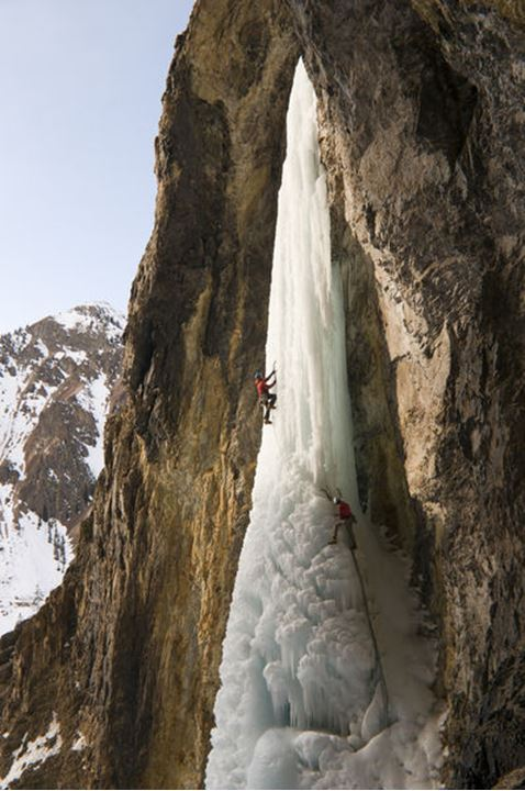 A man and woman ice climbing the frozen waterfall called the Whorehouse Ice Hose, Silverton, Colorado.