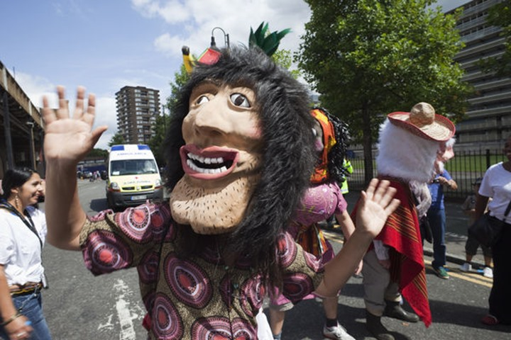"""England, London, Southwark, Masked Participant in the """"Carnaval Del Pueblo"""" Festival (Europes largest Latin Street Festival)"""
