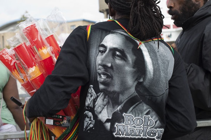 England, London, Notting Hill Carnival, Whistle and Whoofer Horn Vendors Tee Shirt with Bob Marley Image