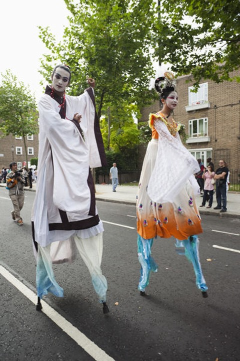 England, London, Notting Hill Carnival, Chinese Stilt Walkers
