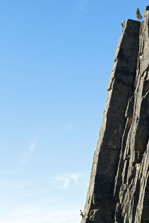 Anne Gilbert Chase topping out on Sparerib (5.8), as Emily Stifler belays, on a perfect spring day in Gallatin Canyon Montana