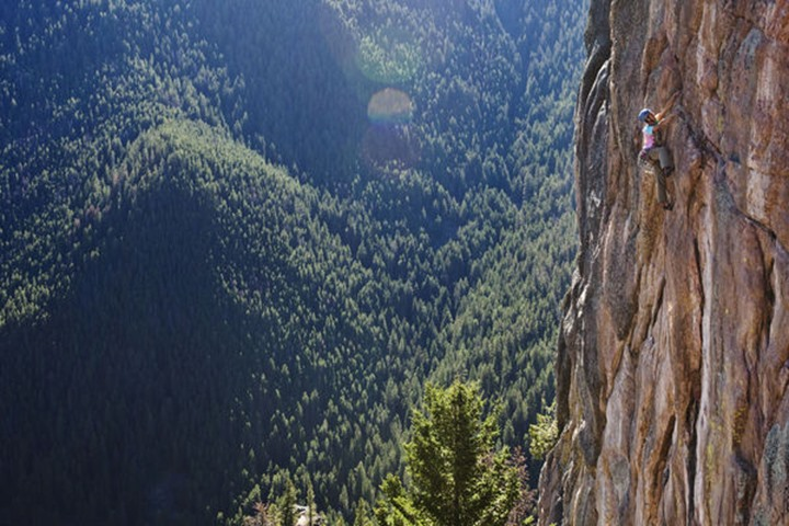 A athletic man rock climbing in Gallatin Canyon near Bozeman, Montana.