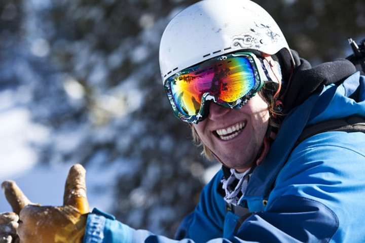 A athletic man smiling in the backcountry in Cooke City, Montana.