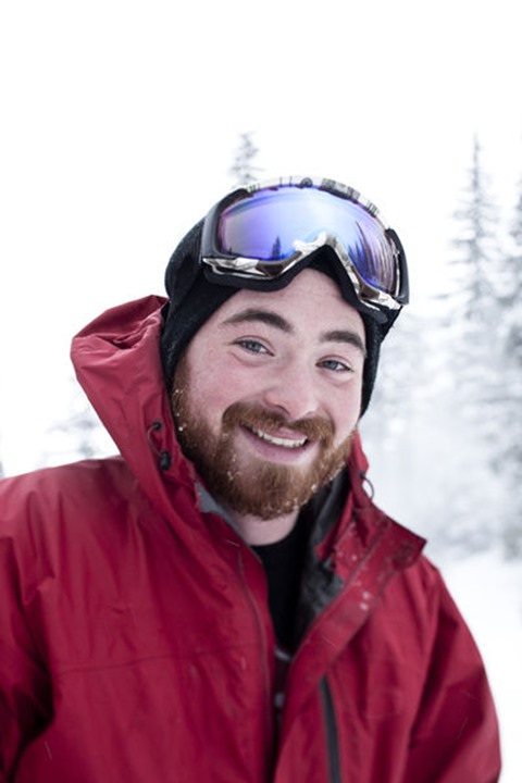 A happy young man smiles while taking a break from skiing at Schweitzer Mountain in Sandpoint, Idaho.