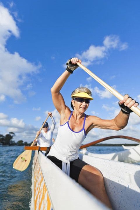 Janina Wade, 62 years old, is paddling in an outrigger canoe on November 22nd 2011 in the Noosa River, Queensland, Australia.