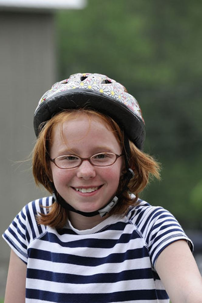 A young girl sports a helmet on her bike ride in PA.