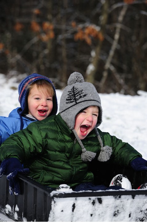 Two young boys having fun playing in the snow in northeast PA