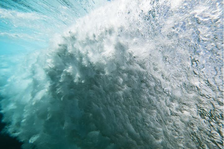 Underwater view of a wave breaking on a reef, Rarotonga, Cook Islands, on the 8 October 2011.