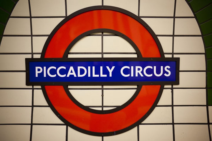 England, London, Piccadilly Circus, Piccadilly Circus Underground Station Sign. Please note that the Underground roundel is TfL's trade mark and permission to reproduce the image for commercial purpos