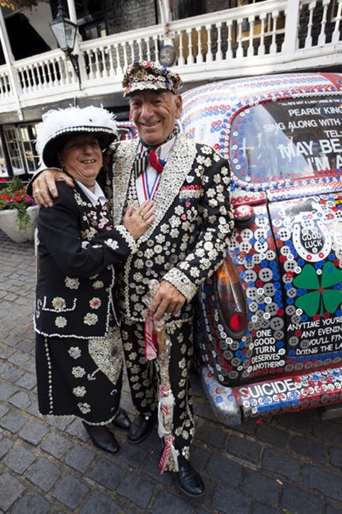 England, London, Pearly King and Queen and Decorated London Taxi