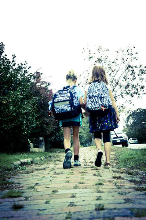two friends walk home from school