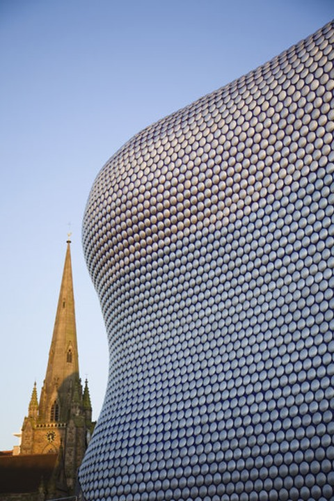 England, Birmingham, Selfridges Department Store designed by future Systems and St.Martins Church Spire at the Bullring Shopping Mall