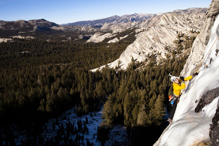 On January 13, 2012 an ice climber climbs Yellow Brick Road (WI3+) on Drug Dome in Tuolumne Meadows located inside Yosemite National Park, California.  The Tioga Pass has not been open this late in t
