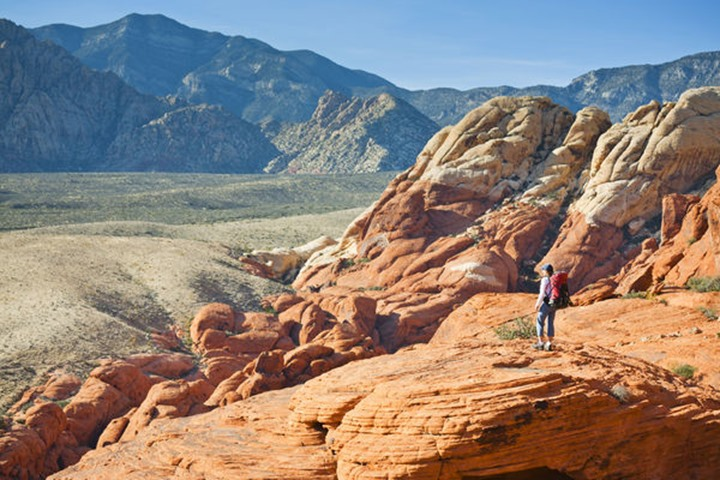 Sabina Allemann, 49 years old, is admiring the view from the Calico Hills area of Red Rock Canyon National Conservation Area on 17th November 2011, Nevada, USA.