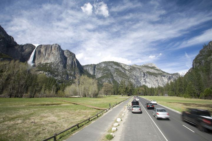 Scenic image of traffic and the park loop running through Yosemite National Park, CA.