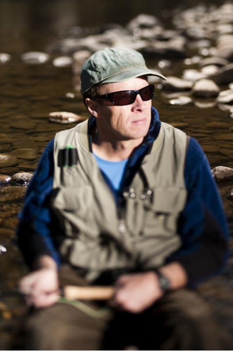 A portrait of Tom Bol about to fly fish on the banks of the Poudre River, near Picnic Rock. Shot with a Tilt Shift Lens.