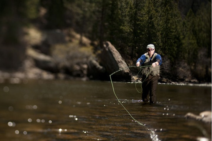 Tom Bol fly fishes in the Poudre River, near Picnic Rock. Shot with a Tilt Shift Lens.