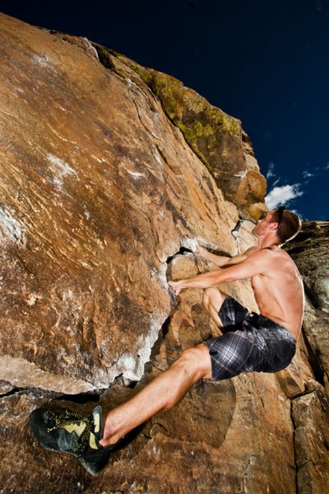 Matt Stallings climbs the Prow at Rotary Park adjacent to Horsetooth Reservoir in Fort Collins, Colorado on October 19, 2009.