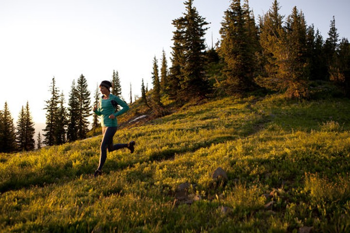 A woman on an early  morning run on the Wasatch Crest trail.