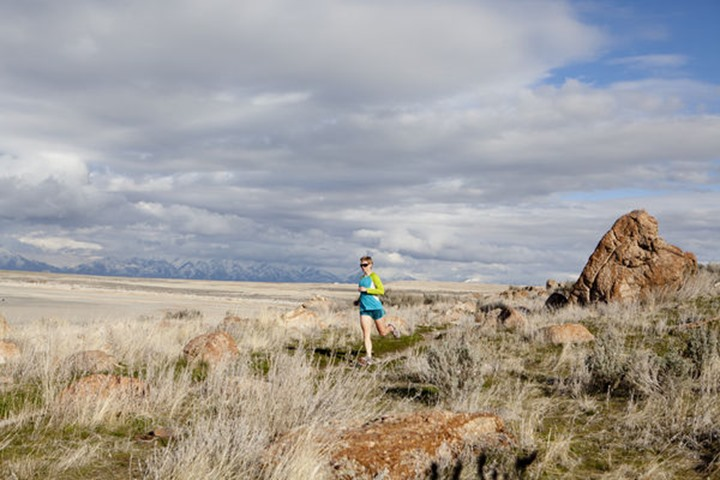A woman out for an afternoon trail run, Antelope Island, Utah