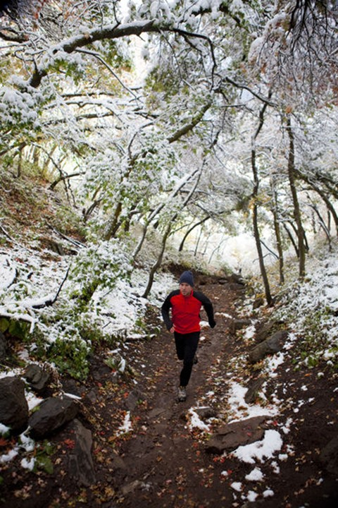 A man out for a run on the pipeline trial after the first snowfall of the season.