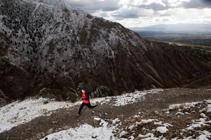 A man out for a run on the pipeline trial above Salt Lake City after the first snowfall of the season.