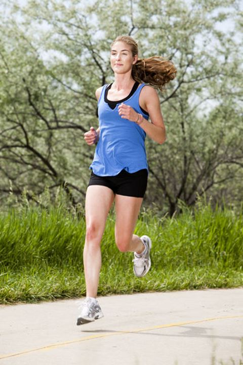 Melissa Lombardi runs along a bike trail on a warm sunny day.