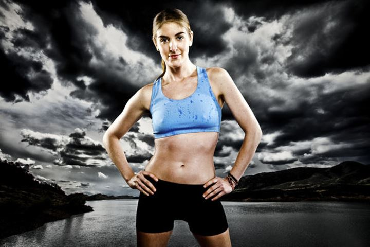 Melissa Lombardi poses while running with a blue sports bra and black running shorts in front of Horsetooth Reservoir. Composite.