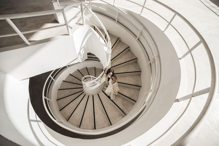 Woman in spiral staircase