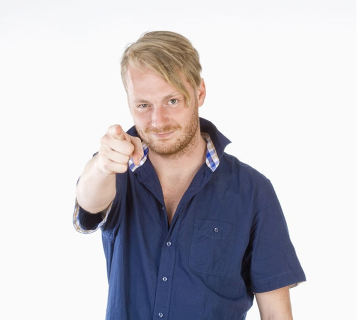 Young Man Making a Pointing Gesture with his Finger