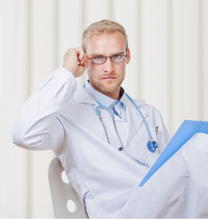 Portrait of a Young Doctor with Stethoscope and Glasses Looking