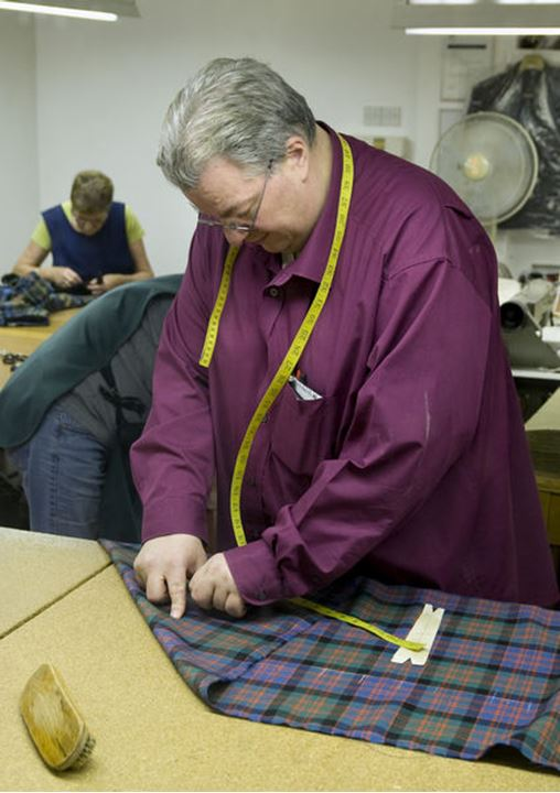 A man makes a kilt in Inverness, Scotland (Skottland) no model release