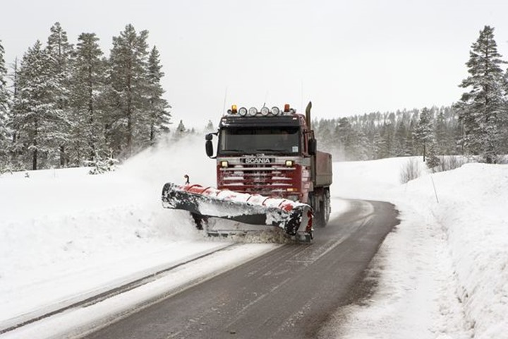 Clearing snow plow