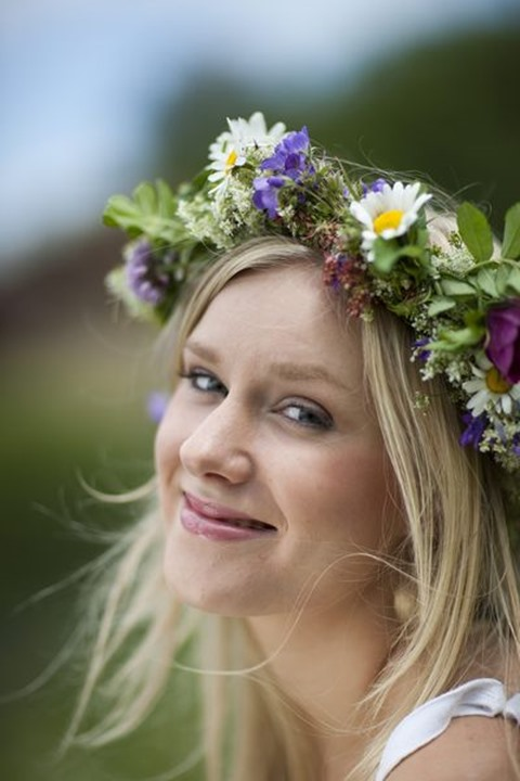 Maja Dahlström with flowers in her hair.