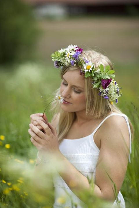Maja Dahlström in a summer meadow, Midsummer