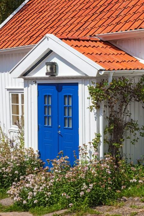 Small cottage with blue door