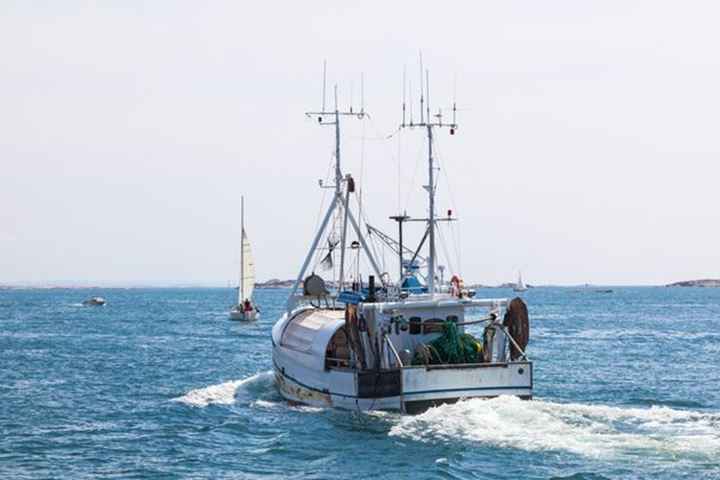 Fishing boat heading out to sea