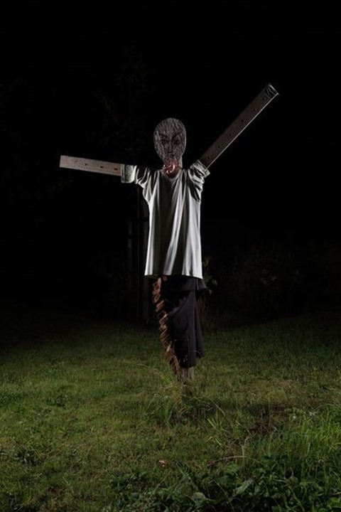 Scarecrow at night, Sweden.