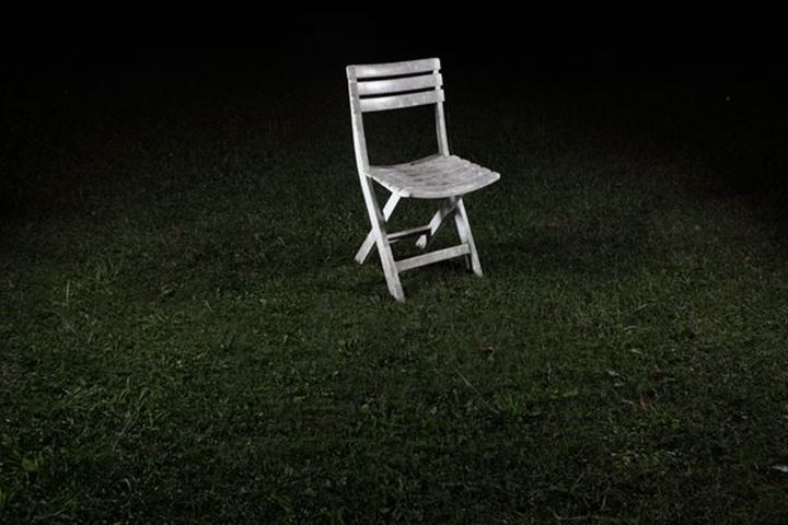 A chair on a lawn during night, Sweden.