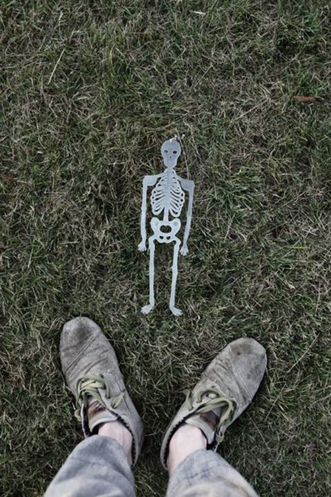 Toy skeleton and a pair of feet, Sweden.