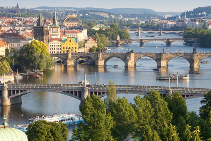 Czech Republic, Prague - Bridges over Vltava River and Boat Traffic.