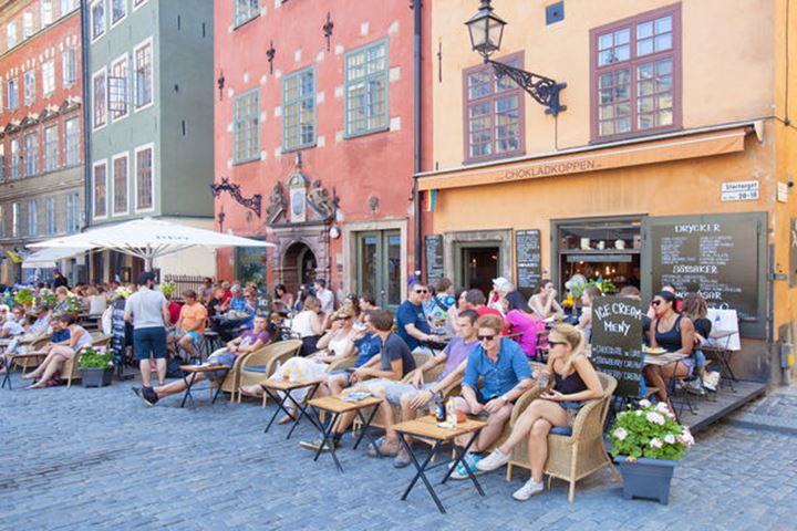Sweden, Stockholm - People sitting at cafŽ in The Old Town.