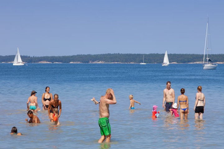Sweden, Stockholm - People having fun in water at Uto outer archipelago